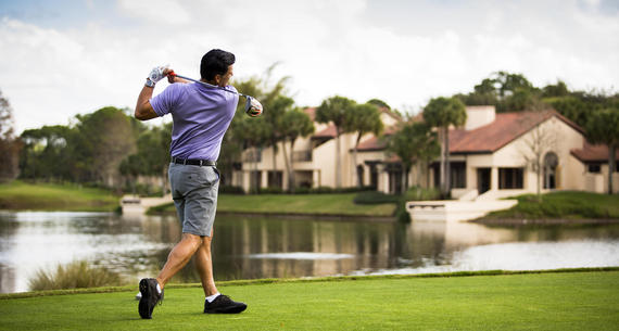 man golfing at villas of grand cypress